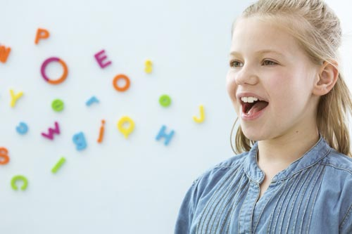 child practicing speech therapy